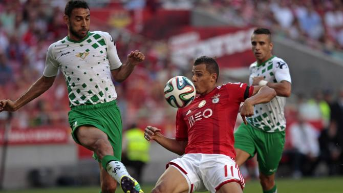 Benfica's  Rodrigo Lima  fights for the ball with Moreirense's Danielson Trindade during their Portuguese Premier League soccer match at the Luz stadium in Lisbon