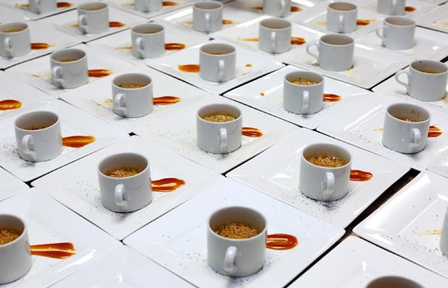 A coffee-soda dessert by Chef Ryan Scott demonstrates the quality of McDonald's raw ingredients at a McDonald's culinary event for charity. The event was held at the California Culinary Academy on Thu