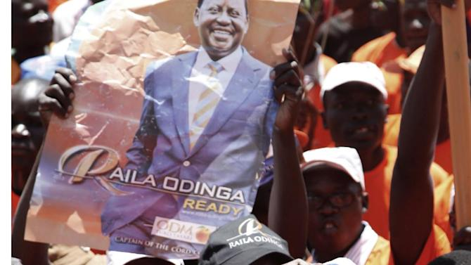 A supporter of Kenyan Prime Minister and Presidential candidate, Raila Odinga, wears a gorilla mask as he joins a rally at Nyayo National Stadium, Nairobi, Kenya, Saturday, March 2, 2013 for the final day of the campaign for the election. Kenya will hold its national election March 4, 2013. (AP Photo/Sayyid Azim)