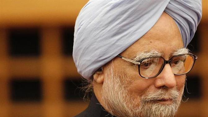 Prime Minister Manmohan Singh walks into a room to deliver his speech at a hotel in Tokyo May 28, 2013. REUTERS/Yuya Shino/Files