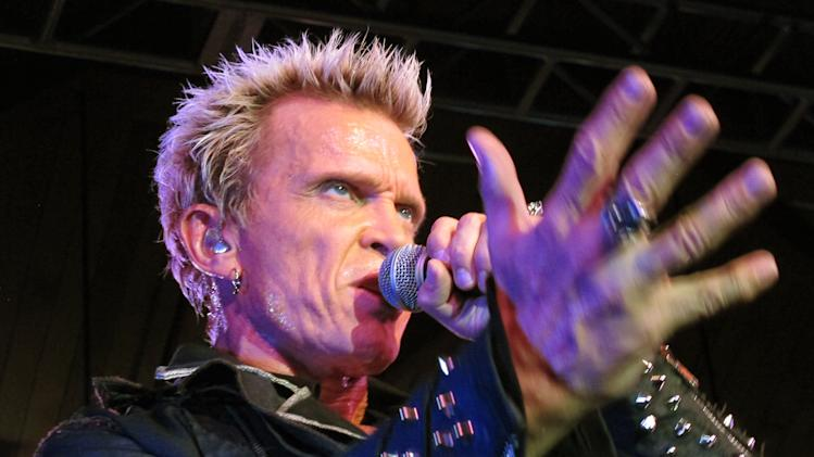 Billy Idol performs Friday, Oct. 26, 2012, in Seattle. Idol came to play in Seattle after Michael Henrichsen launched a two-year grass-roots campaign to convince the rock star to play for his birthday party. (AP Photo/Gene Johnson)