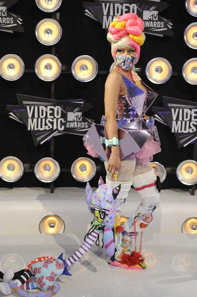 FILE - In this Aug. 28, 2011 file photo, singer Nicki Minaj arrives at the MTV Video Music Awards in Los Angeles. Minaj is part of a group of contemporary pop singers who are finding success defying the conventional definition of sexiness with oddball tactics and wacky outfits.  (AP Photo/Chris Pizzello, file)