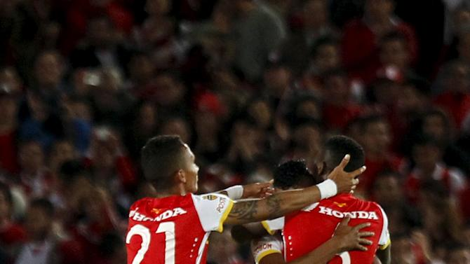 Players of Colombia's Santa Fe celebrate after their Copa Sudamericana soccer match against Paraguay's Sportivo Luqeno in Bogota