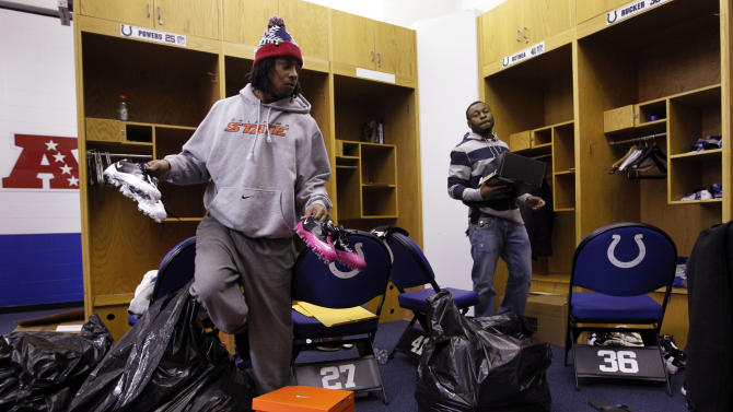 Indianapolis Colts cornerback Jacob Lacey, left, and free safety Antoine Bethea clear out their lockers at the NFL team's football practice facility in Indianapolis, Monday, Jan. 2, 2012. The Colts finished the season with a 2-14 record. (AP Photo/Michael Conroy)