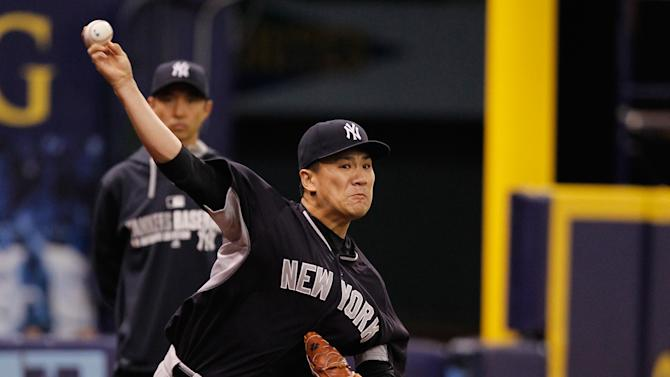 Masahiro Tanaka of the New York Yankees pitches in his first bullpen session since being placed on the disabled list at Tropicana Field on August 16, 2014 in St Petersburg, Florida