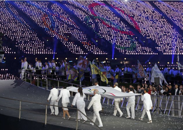 The Olympic flag is carried during the opening ceremony of the London 2012 Olympic Games