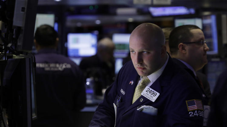 In this Thursday, Feb. 14, 2013 photo, specialist Joe Parisi works at his post on the floor of the New York Stock Exchange, in New York. Disappointing news about Germany's economy sent Asian stock markets down on Friday, Feb. 15, 2013. (AP Photo/Richard Drew)
