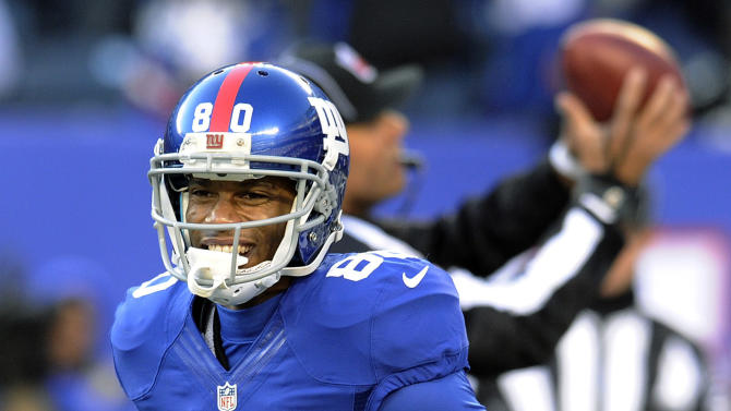 New York Giants wide receiver Victor Cruz (80) celebrates after catching a pass during the first half of an NFL football game against the Philadelphia Eagles, Sunday, Dec. 30, 2012, in East Rutherford, N.J. (AP Photo/Bill Kostroun)