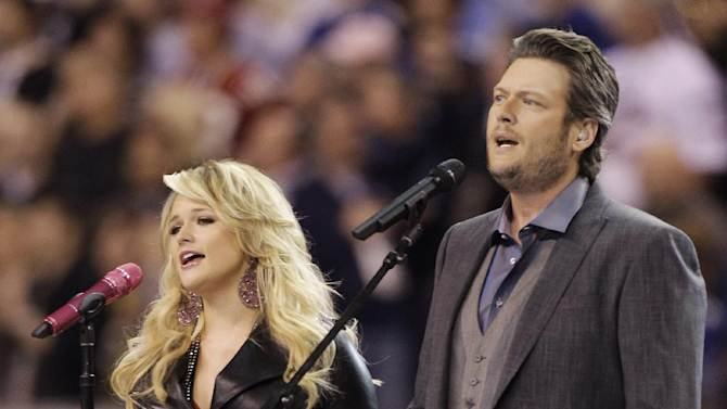 """Blake Shelton, right, and Miranda Lambert sing """"America the Beautiful"""" before the NFL Super Bowl XLVI football game between the New York Giants and the New England Patriots, Sunday, Feb. 5, 2012, in Indianapolis. (AP Photo/Chris O'Meara)"""