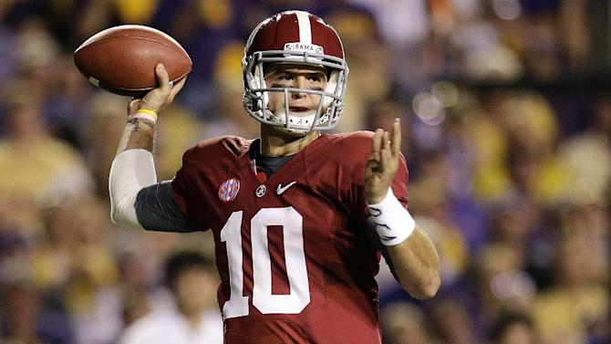 Alabama quarterback AJ McCarron (10) passes in the first half of their NCAA college football game against LSU in Baton Rouge, La., Saturday, Nov. 3, 2012. (AP Photo/Bill Haber)