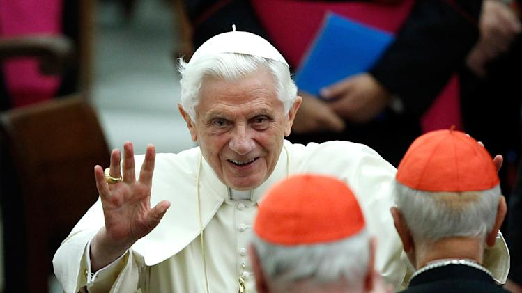 FILE - This Nov. 26, 2011 file photo shows Pope Benedict XVI waving as he leaves Paul VI hall after attending a concert of the Asturias Principality Symphony Orchestra directed by Chilean conductor Maximiano Valdes, at the Vatican. On Monday, Feb. 11, 2013 the Vatican announced that Pope Benedict XVI will resign on Feb. 28, 2013. (AP Photo/ Isabella Bonotto, file)