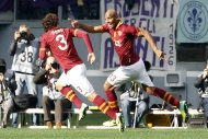 AS Roma's Douglas Maicon (R) celebrates with his teammate Dodo after scoring against Fiorentina during their Italian Serie A soccer match at the Olympic stadium in Rome December 8, 2013. REUTERS/Giampiero Sposito (ITALY - Tags: SPORT SOCCER)