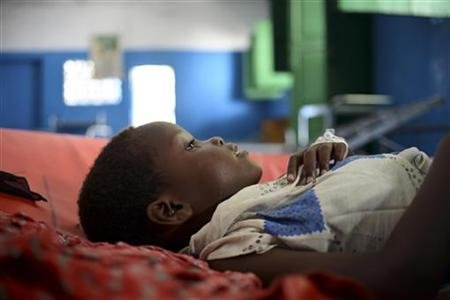 A child rests on a bed in Marka's main hospital December 18, 2012. REUTERS/Tobin Jones/AU-UN IST/Handout