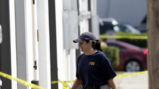 An FBI agents enters Arc Electronics Inc. Wednesday, Oct. 3, 2012 in Houston. A Kazakhstan-born businessman was charged in the U.S. on Wednesday with being a secret Russian agent involved in a scheme to illegally export microelectronics from the United States to Russian military and intelligence agencies. (AP Photo/David J. Phillip)
