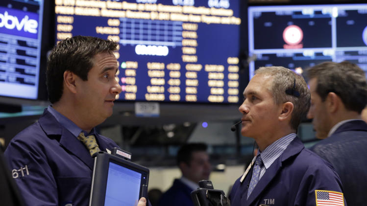 A pair of traders confer on the floor of the New York Stock Exchange Tuesday, March 19, 2013. A surprisingly strong increase in new home construction is sending stocks higher in early trading on Wall Street. (AP Photo/Richard Drew)