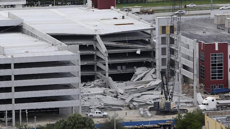 A five-story parking garage is shown after it collapsed at Miami-Dade College, Wednesday, Oct. 10, 2012 in Doral, Fla., killing one worker and trapping two others in the rubble, officials said. Several other workers were hurt, including one rescued from the debris. (AP Photo/Lynne Sladky)