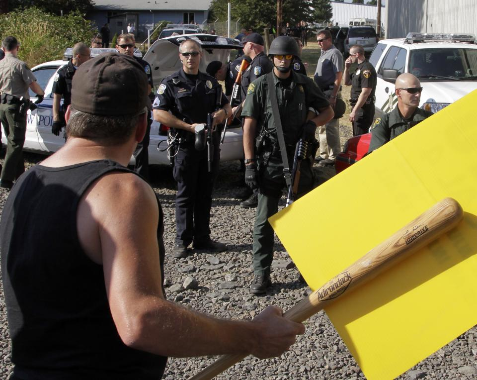 Police and union workers face off during a tense moment as union workers block a grain train in Longview, Wash.,  Wednesday, Sept. 7, 2011.   Longshoremen  blocked the train as part of an escalating dispute about labor at the EGT grain terminal at the Port of Longview.(AP Photo/Don Ryan)