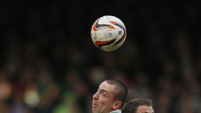 Dundee United's Rankin challenges Celtic's Brown during their Scottish Premier League soccer match at Tannadice Park Stadium in Dundee