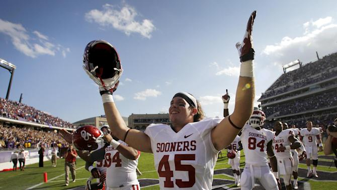 Oklahoma's Caleb Gastelum (45) and teammates salute with fans in the stands after their NCAA college football game against TCU Saturday, Dec. 1, 2012, in Fort Worth, Texas. Oklahoma won 24-17. (AP Photo/Tony Gutierrez)