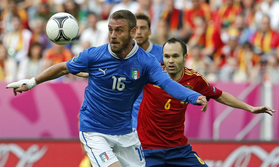 Italy's Daniele De Rossi, left, and Spain's Andres Iniesta duel for the ball during the Euro 2012 soccer championship Group C match between  Spain and Italy in Gdansk, Poland, Sunday, June 10, 2012. (AP Photo/Gregorio Borgia)