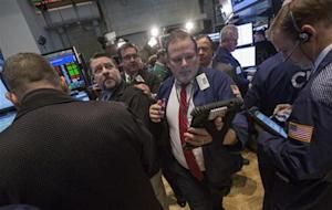 Traders work on the floor of the New York Stock Exchange March 5, 2014. REUTERS/Brendan McDermid
