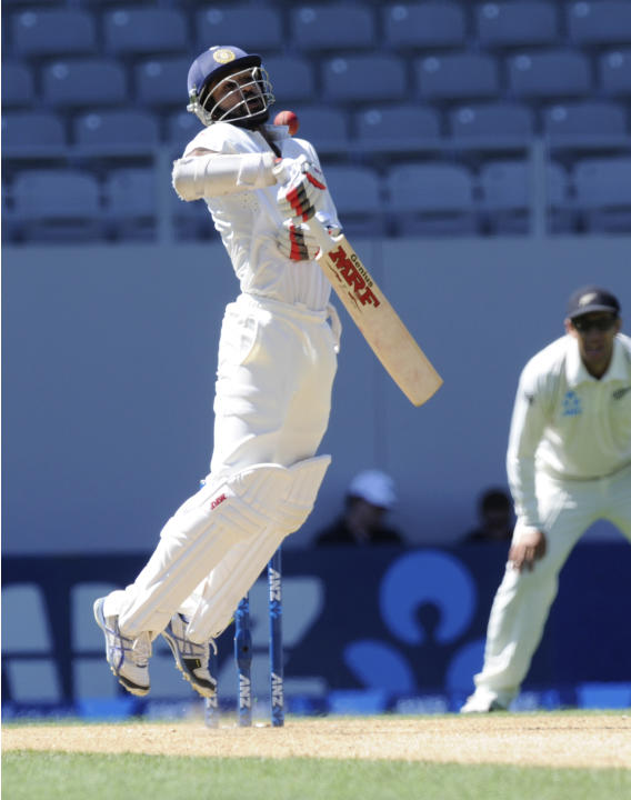 India's Shikar Dhawan plays a high ball to be caught out for 115 by New Zealand's wicket keeper off the bowling of Neil Wagner BJ Watling on the fourth day of the first cricket test at Eden Park, Auck