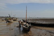 "Fishermen standing by their boats on the island of Shweri Chai in the Bay of Bengal, off the western city of Sittwe, capital of Rakhine state, in April 2012. Myanmar authorities warned Monday against ""anarchic acts"" after an angry mob killed 10 Muslims and a crowd attacked a police station in a surge in sectarian tensions in the west of the country"