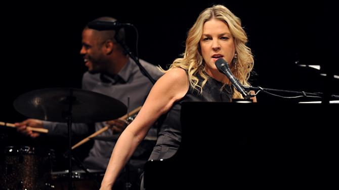 """FILE - In this Nov. 20, 2009 file photo, Canadian jazz pianist and singer Diana Krall performs in Universal Hall in Macedonia's capital Skopje. Krall says she felt reinvigorated making her new CD """"Glad Rag Doll"""" which gave her a chance to escape the comfort zone of Great American Songbook standards on which the singer-pianist has built her reputation. (AP Photo/Boris Grdanoski, File)"""