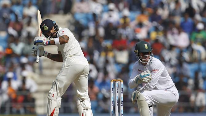 India's captain Kohli and South Africa's wicketkeeper Vilas watch the ball played by Kohli on the first day of their third test cricket match in Nagpur