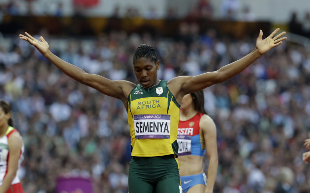 South Africa's Caster Semenya raises her arms following her women's 800-meter semifinal during the athletics in the Olympic Stadium at the 2012 Summer Olympics, London, Thursday, Aug. 9, 2012. (AP Photo/Lee Jin-man)