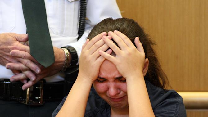 Jennifer Mee, once known for her unstoppable hiccups, reacts to testimony of a family member of Shannon Griffin while appearing during a bond reduction hearing at the Pinellas County Criminal Justice Center in Largo, Fla. on Tuesday, Nov. 2, 2010. St. Petersburg police have charged Mee with first-degree murder after they say she lured a 22-year-old man to a meeting where he was robbed and shot. (AP Photo/Douglas R. Clifford, Pool)