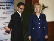 U.S. Secretary of State Hillary Rodham Clinton, right, is greeted by Indonesian Foreign Minister Marty Natalegawa prior to their Joint Commission Meeting Indonesia-U.S. in Nusa Dua, Bali, Indonesia, Sunday, July 24, 2011. (AP Photo/Dita Alangkara)
