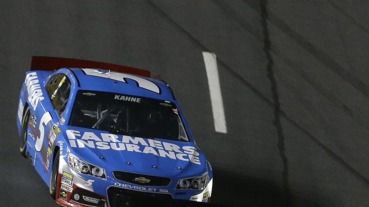 Jimmie Johnson (48) leads Kasey Kahne (5) during the final laps of NASCAR Sprint Cup Series All-Star auto race at Charlotte Motor Speedway in Concord, N.C., Saturday, May 18, 2013. Johnson won the race. (AP Photo/Gerry Broome)