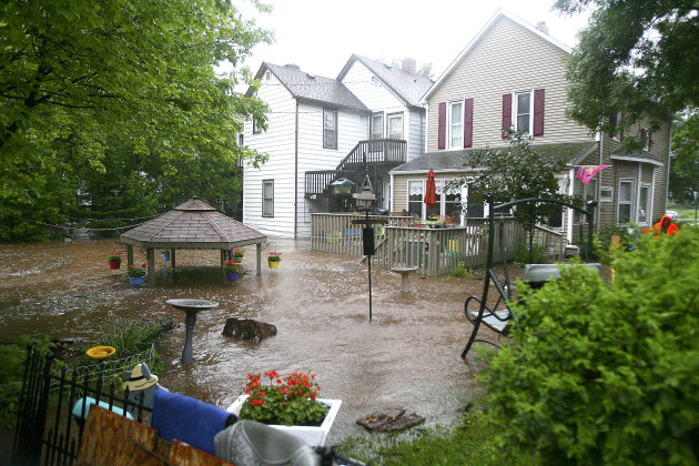 Water flowing from Miller Creek fills the backyards of several homes on West Second Street in Duluth, Minn. after record rainfall hit the area on Wednesday June, 20, 2012. Most areas received seven to