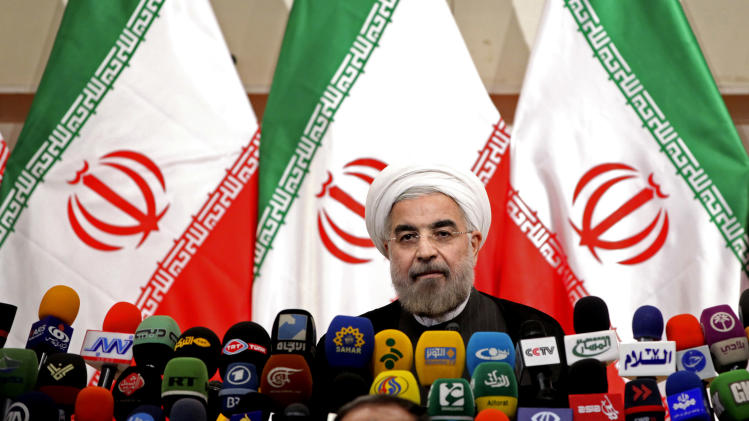 "Iranian newly elected President Hasan Rowhani, listens during a press conference, in Tehran, Iran, Monday, June 17, 2013. Rowhani showcases his reformist image by promising a ""path of moderation,"" the easing of nuclear tensions and steps to narrow the huge divide with the United States. He also make clear where he won't go, saying he opposes any halt to uranium enrichment, at the heart of the nuclear standoff. (AP Photo/Ebrahim Noroozi)"
