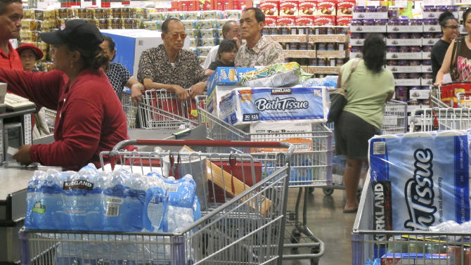 Shoppers prepare for a hurricane and tropical storm heading toward Hawaii