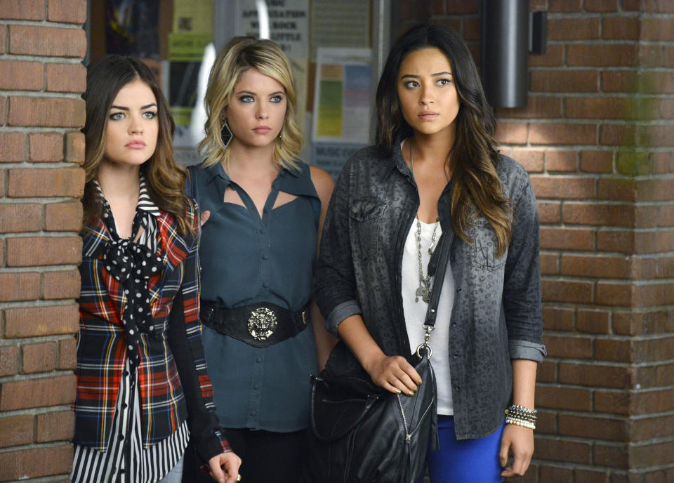 "This publicity image released by ABC Family shows, from left, Lucy Hale, Ashley Benson and Shay Mitchell in a scene from ""Pretty Little Liars.""  On Tuesday, March 26, 2013, ABC Family approved a new series called ""Ravenswood,"" a spin-off of ""Pretty Little Liars."" (AP Photo/ABC Family, Eric McCandless)"