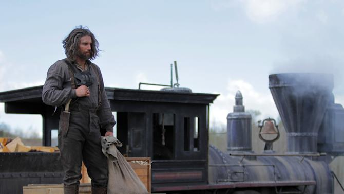 "This image released by AMC shows Anson Mount as Cullen Bohannon in a scene from ""Hell On Wheels,"" airing Sundays at 9 p.m. EST on AMC. Returning for its second season, AMC's ""Hell on Wheels"" focuses on Cullen Bohannon, a former Confederate soldier who after the war heads west to Nebraska to work on the transcontinental railroad and, he hopes, avenge the death of his wife at the hands of someone likely to be found at the Union Pacific construction camp. (AP Photo/AMC, Michelle Faye)"