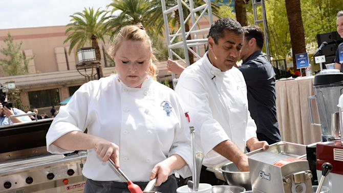 IMAGE DISTRIBUTED FOR CHASE SAPPHIRE PREFERRED - Chef Michael Mina and Le Cordon Bleu student Krista Burdick compete at the Chase Sapphire Preferred Grill Challenge at Emeril's New Orleans Seafood Extravaganza during Vegas Uncork'd by Bon Appetit, at MGM Grand on Saturday, April 25, 2015 in Las Vegas. (Photo by Evan Agostini/Invision for Chase Sapphire Preferred/AP Images)