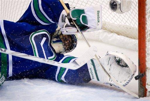 Canucks' Burrows and Sedins combine for 10 points
