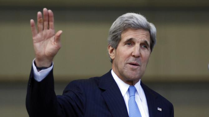 U.S. Secretary of State John Kerry waves journalist after a press conference at the headquarters of the Colombian National Police Counter-Narcotics in Bogota, Colombia, Monday, Aug. 12, 2013. Kerry is on a one-day official visit to Colombia. (AP Photo/Fernando Vergara)