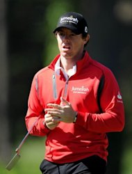 Rory McIlroy of Northern Ireland reacts to his putt during a practice round prior to the start of the 112th U.S. Open at The Olympic Club on June 12, 2012 in Daly City, California