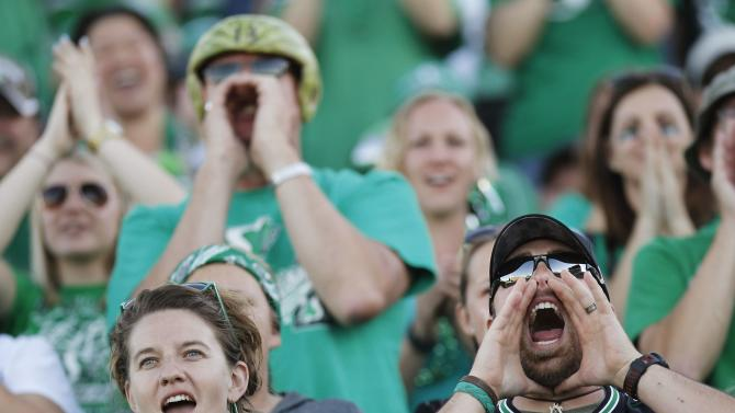 Saskatchewan Roughriders fans cheer on their team playing against the Ottawa Redblacks during the second half of their CFL football game in Regina