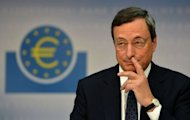 Mario Draghi, President of the European Central Bank (ECB), addresses the media following a meeting with the ECB&#39;s council in Frankfurt am Main, western Germany, on September 6. Asian markets surged and the euro broke the 100 yen barrier after the European Central Bank unveiled a plan to buy troubled eurozone nations&#39; bonds in a bid to tackle the region&#39;s debt crisis