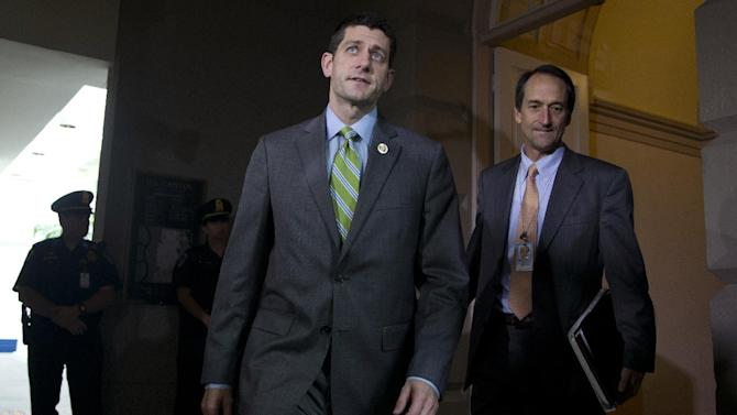 Rep. Paul Ryan, R-Wis., arrives for a meeting with House Republicans in the Capitol in Washington, Wednesday, Oct. 16, Capitol Hill, Wednesday, Oct. 16, 2013, in Washington, after Senate leaders reached last-minute agreement Wednesday to avert a threatened Treasury default and reopen the government after a partial, 16-day shutdown. (AP Photo/Carolyn Kaster)
