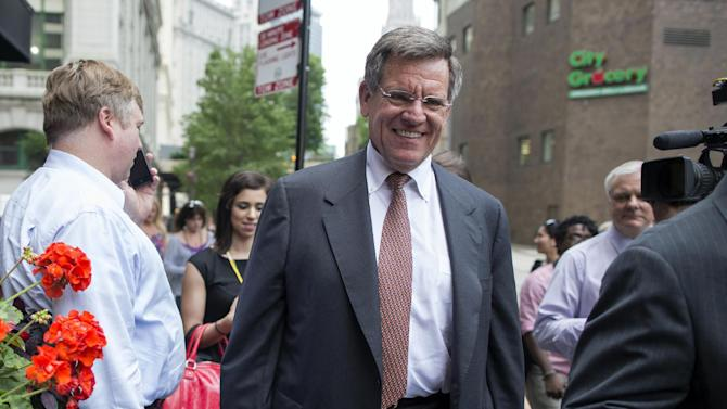 Chicago Blackhawks NHL hockey owner Rocky Wirtz arrives at Phil Stefani's Steakhouse in Chicago, Tuesday, June 25, 2013. Wirtz was joined by Blackhawks President and CEO John McDonough at the restaurant along with the Stanley Cup trophy. The Blackhawks defeated the Boston Bruins to win the championship on Monday. (AP Photo/Scott Eisen)