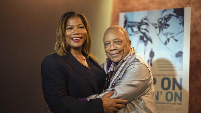 """Cast member Quincy Jones and actress Queen Latifah pose at the premiere of the documentary """"Keep on Keepin' On"""" at The Landmark theatre in Los Angeles"""