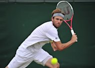 American Mardy Fish during his Wimbledon match against France&#39;s Jo-Wilfried Tsonga on July 3. Fish has played a limited schedule this season and missed two months with his medical condition. He starts play on Tuesday against German Bjorn Phau