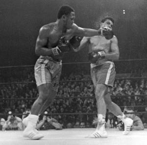 FILE - In this March 8, 1971, file photo, Muhammad Ali. right, takes a left from Joe Frazier during the 15th round of their heavyweight title boxing bout in New York. Frazier won a unanimous decision.   Frazier, the former heavyweight champion who handed Ali his first defeat yet had to live forever in his shadow, died Monday Nov. 7, 2011 after a brief  fight with liver cancer. He was 67. (AP Photo/File)