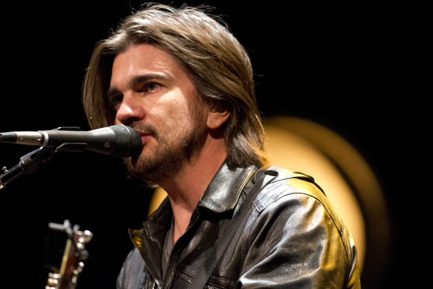 Colombian singer Juanes warms up during a sound check before his concert in Washington, Thursday, July 26, 2012. (AP Photo/Jacquelyn Martin)